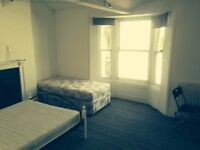 Lovely large double room available in shared house in Brighton .