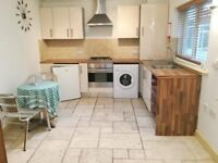 MODERN PART FURNISHED 1 BEDROOM GROUND FLOOR FLAT WITH PARKING AND COMMUNAL GARDEN IN TOWN CENTRE