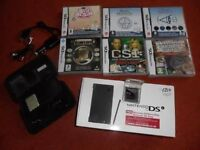 DSi console, accessory pack and games