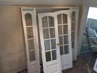 hard wooden doirs with side screens and glass panels