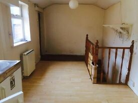 High yield buy to let freehold 1 bed house with yard in Yeovil with a long term tenant only £55000
