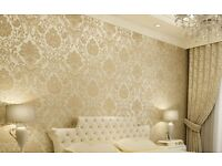 Wallpapering walls and ceiling.