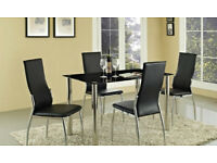 Black glass dining table and four chairs