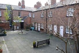 2 bed furnished terrace house to rent within city walls. Available Immediately