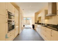 WOW!4 bedroom townhouse with Downstairs cloakroom,rear garden,roof terrace in Bow Common Lane