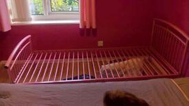 Pink single metal bed