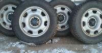 4 steel wheels and 2 215-70-16 winter tires