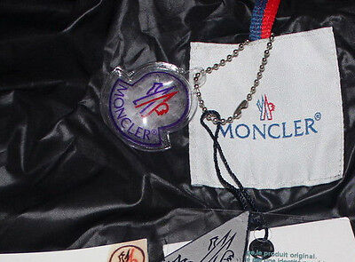Moncler jackets DO NOT come with a small plastic bubble containing a sample of the down fill. Anytime you see this, it's a fake.