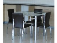 Glass & chrome extendable dining table and four dark brown faux leather & chrome chairs. As new.