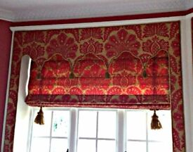 Roman blinds, window surrounds, bolsters and cushions in red and gold.