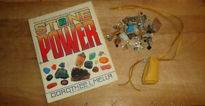 New Age healing stones, book and leather pouch