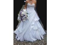 White, taffeta and jewelled wedding dress, underskirt and veil.