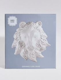 M&S wall mounted lion heads