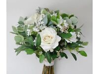 white or ivory bridal posies and bouquets. top quality flowers and foliage.