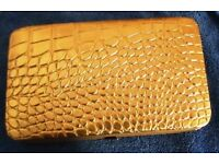 BRAND NEW GOLD MORGAN PURSE/CLUTCH. WRIST STRAP.