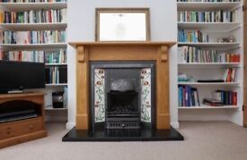Gas fire with beautiful tile and oak surround