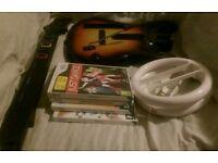 Nintendo Wii + 6 games + guitar