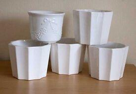 Five ceramic plant pots