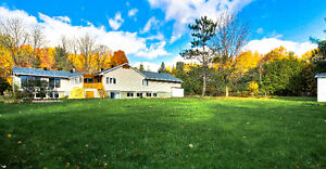 Spacieux bungalow à Vaudreui-Dorion sur 54000sq pieds de terrain