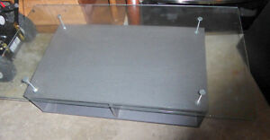 Modern coffee table on wheels with shelves and glass top - AS IS