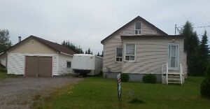 perfect place to start or retire. 2 bdrm, dtch garage on .5 acre