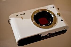 Nikon 1 J1 10.1 MP HD Mirrorless Digital Camera (No lens)