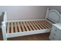 Single bed with night stand