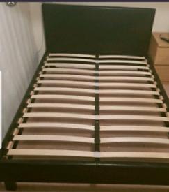 Black faux leather king-size bedframe