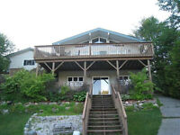 Short drive to a beautiful home on Windy lake in a quiet bay