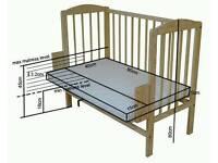 White wooden baby co-sleeper crib