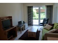 Furnished 2 b/room comfortable & well-presented flat for festival period (free parking)