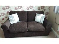 Matching pair of chocolate sofas £100
