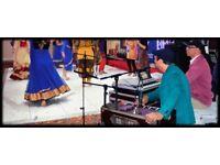 Indian Music Teacher (vocals/Harmonium/keyboard?