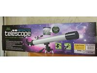 Telescope 50 x 100 with adjustable tripod. Never used