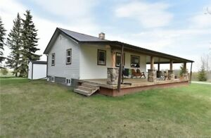 This picture perfect acreage offers extensive landscaping