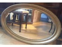 Vintage gold beveled mirror.