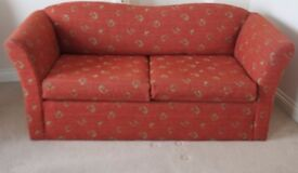 Sprung Sofa Bed - good condition - rust colour with gold swirls