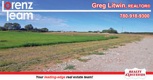 18.26 acres of land with poured 1660 sq/ft walkout basement!