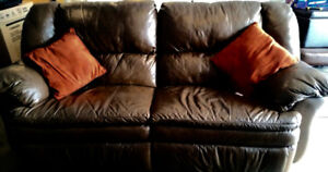Leather Reclining full size Sofa 100% leather paid $1600 4 yrs