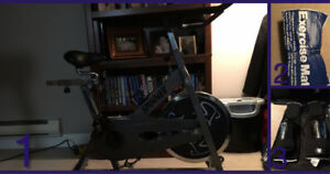 spin bike, exercise mat, boxing gear
