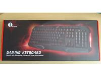 New 114-key Backlit Wired Gaming Keyboard with Multimedia Shortcuts and Breathing Lights