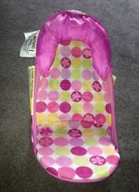 Pink baby bouncer and bath seat