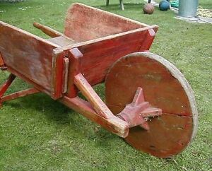 wheel barrow - antique wheel barrow, wood wheel