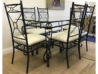 Glass dining table and four padded cream chairs. Good condition. Pref collection only
