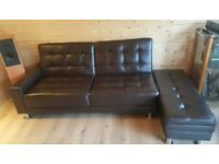 Chocolate brown leather look sofa bed with storage
