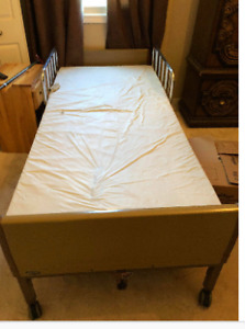 Electric hospital bed with matress and side rails