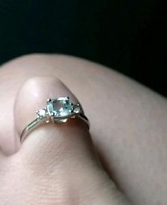 Aquamarine and White Sapphire Three Stone Engagement Ring