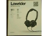 For sale is a pair of Skullcandy Lowrider headphones, bnib.