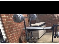 Weight bench with loads of weights