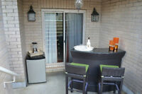 Outdoor patio bar with 2 stools